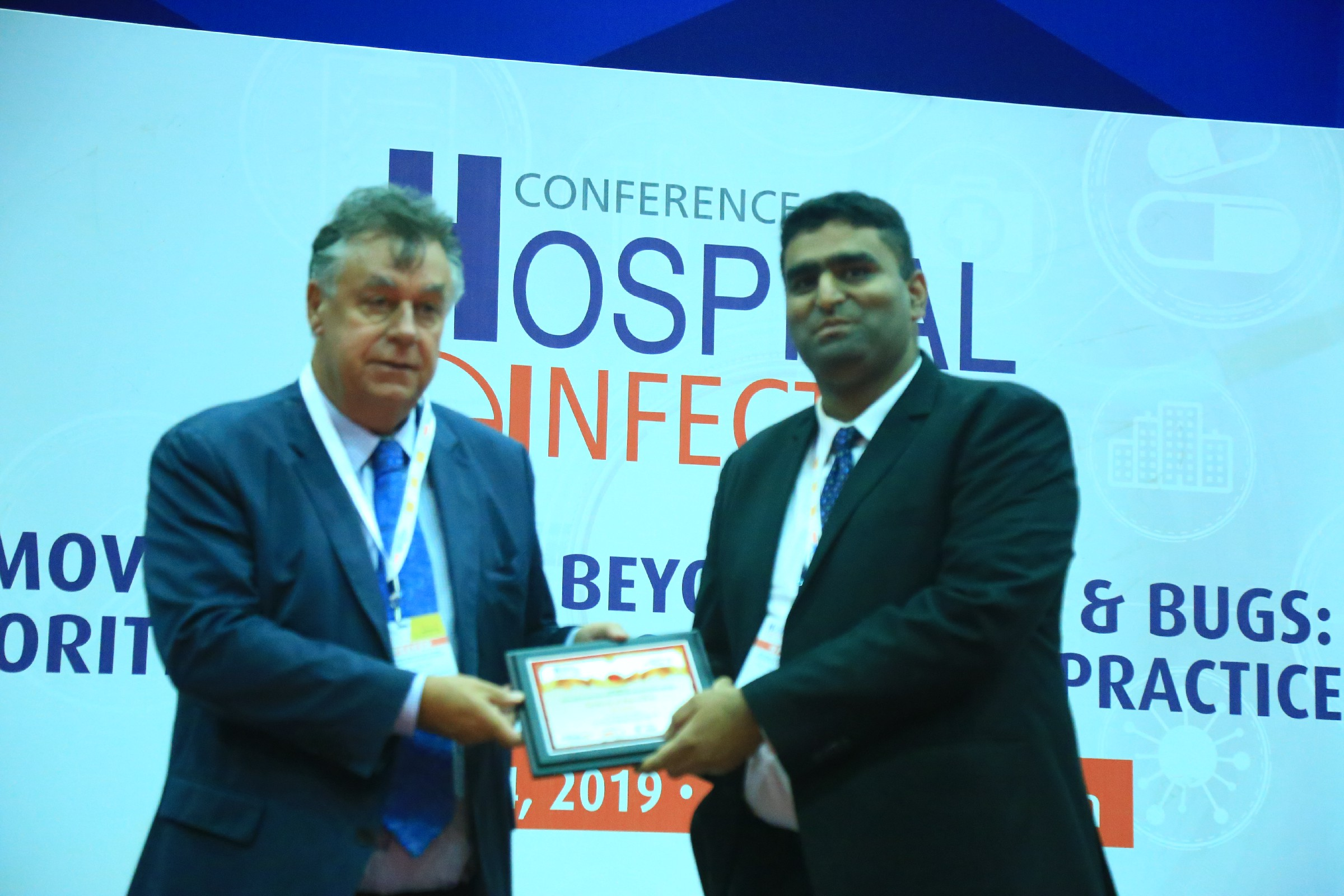 Paul-Hyslop-Group-MD-CEO-Zoono-Group-of-Companies-Dr-Dhruv-K-Mamtora-Consultant-Clinical-Microbiologist-and-Infection-Control-officer-S.-L.-Raheja